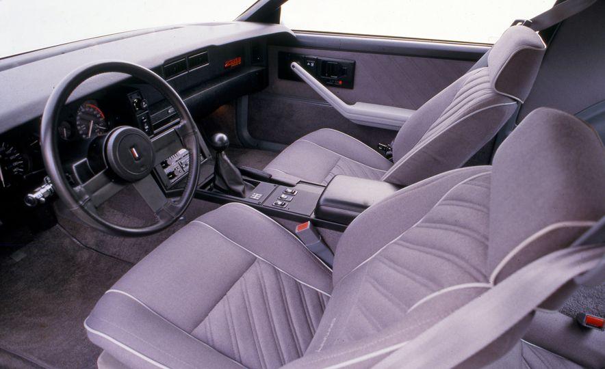 Pontiac Firebird Formula, Chevrolet Camaro IROC-Z, and Ford Mustang GT - Slide 9