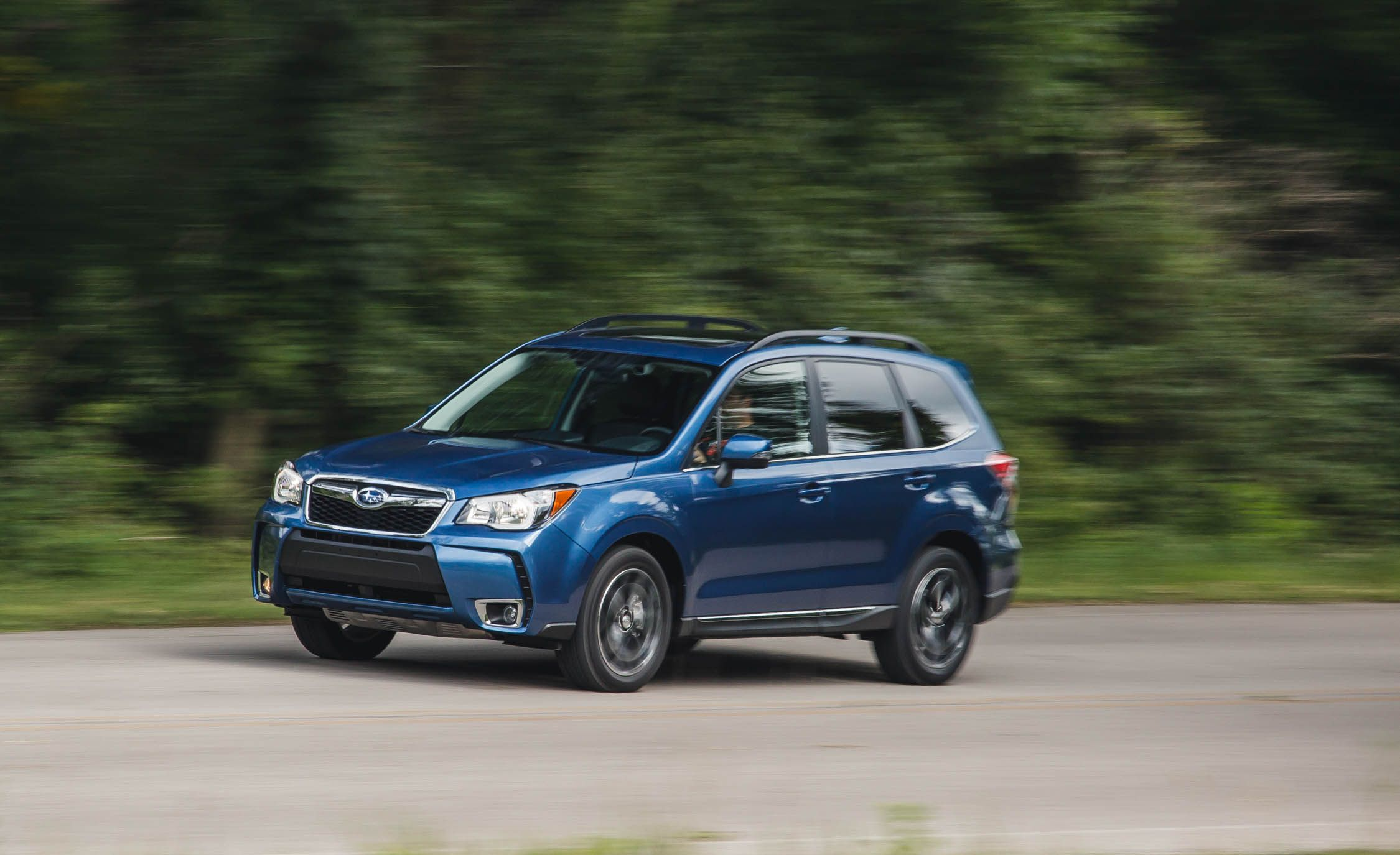 2016 subaru forester pictures | photo gallery | car and driver