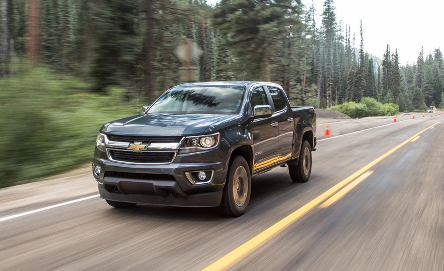 2015 Chevrolet Colorado LT 4WD and 2016 Toyota Tacoma TRD Off-Road 4x4 - Slide 9