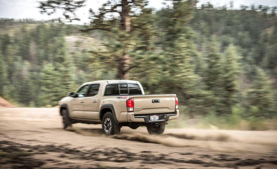 2015 Chevrolet Colorado LT 4WD and 2016 Toyota Tacoma TRD Off-Road 4x4 - Slide 31