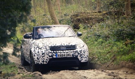 Range Rover Evoque Convertible Wearing Camo in the Woods