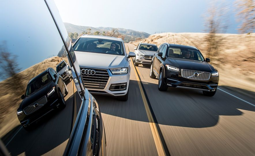 2016 Volvo XC90 T6 AWD Inscription, 2015 BMW X5 xDrive35i, 2015 Land Rover Range Rover Sport HSE, and 2017 Audi Q7 3.0T - Slide 3