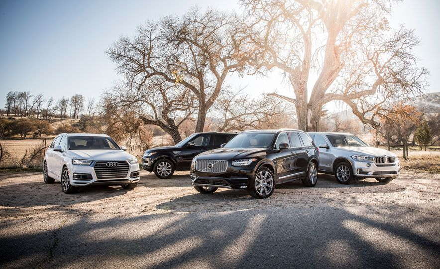 2016 Volvo XC90 T6 AWD Inscription, 2015 BMW X5 xDrive35i, 2015 Land Rover Range Rover Sport HSE, and 2017 Audi Q7 3.0T - Slide 7