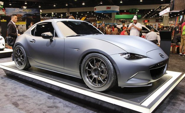 https://hips.hearstapps.com/amv-prod-cad-assets.s3.amazonaws.com/wp-content/uploads/2016/11/Mazda-MX-5-Miata-RF-Kuro-concept-SHOWFLOORPLACEMENT-626x382.jpg