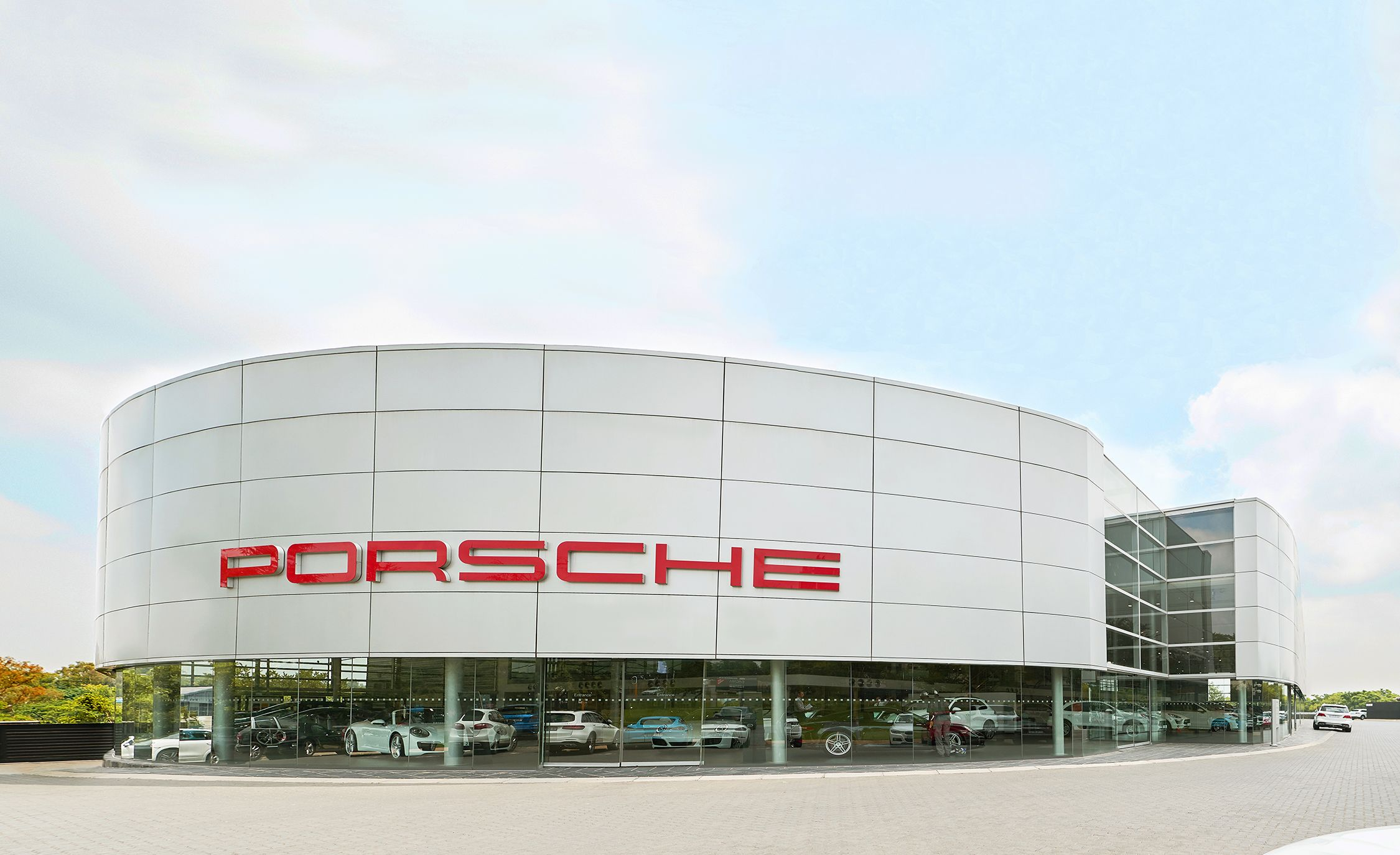 this is the largest porsche dealership in the world flipbook car and driver. Black Bedroom Furniture Sets. Home Design Ideas