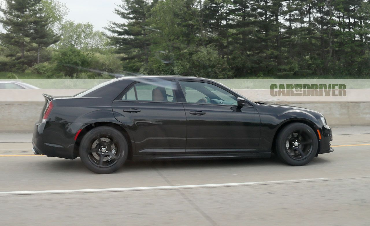 Chrysler 300 srt hellcat spy photo pictures photo gallery car and driver