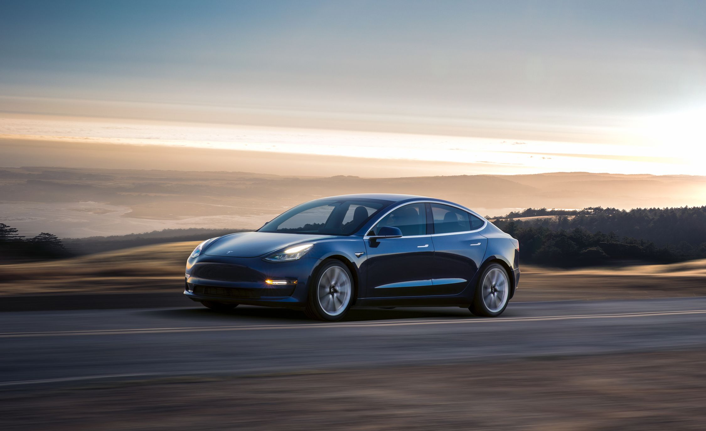 Stand and Deliver: Elon Musk Hands Off First Tesla Model 3 Production Cars