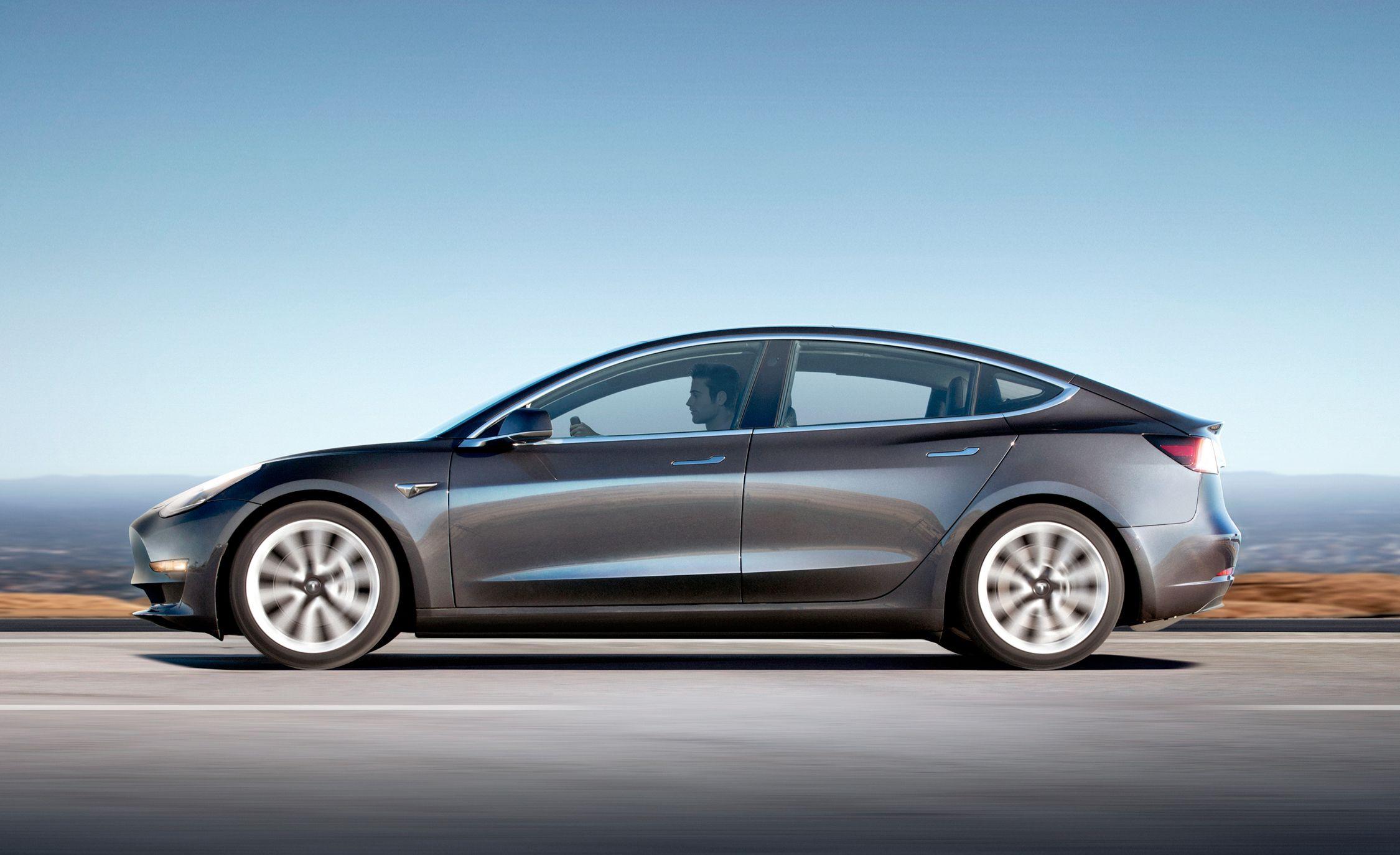 Tesla Model 3 Reviews Price Photos And Specs Car Driver