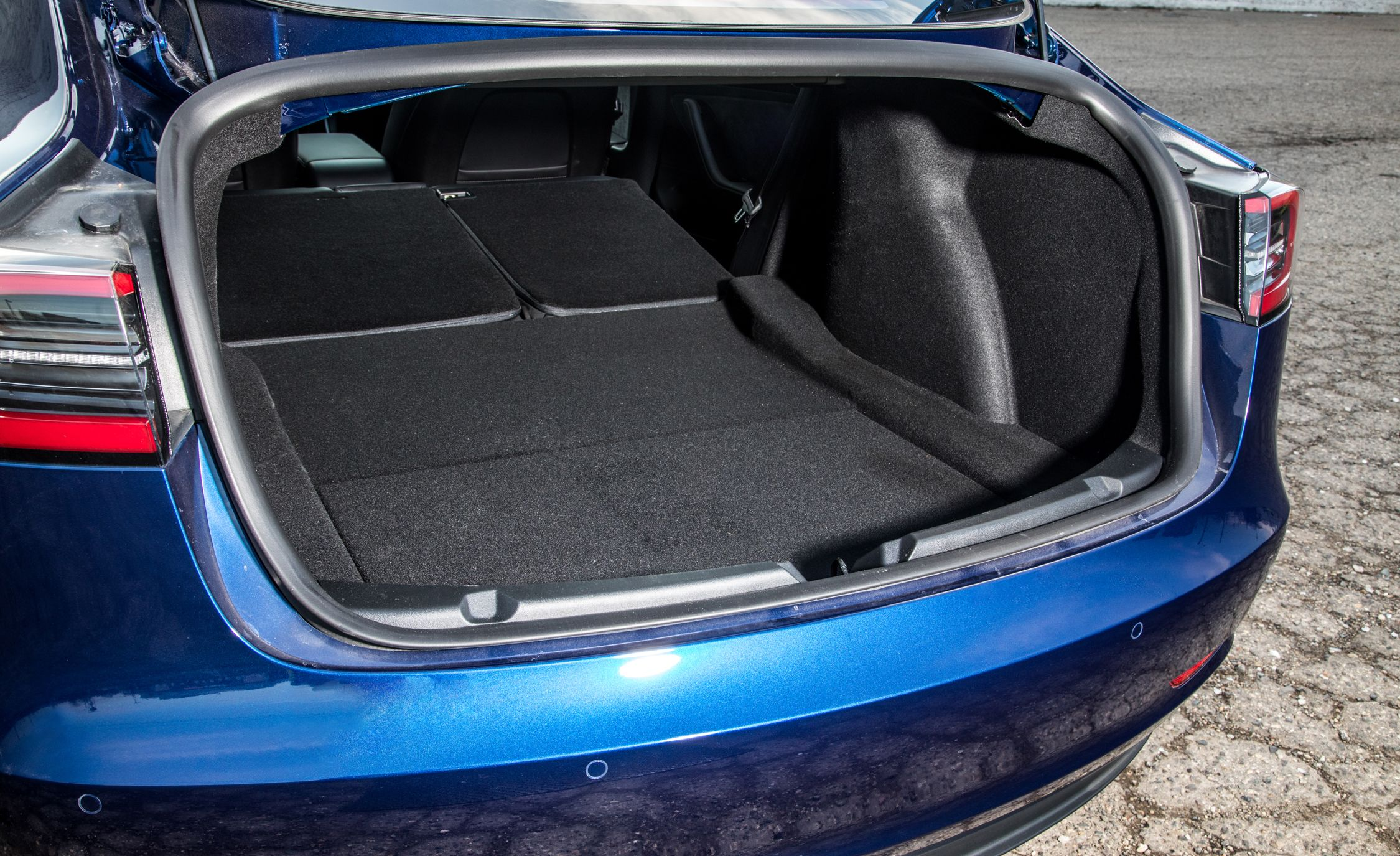 2019 Tesla Model 3 Reviews | Tesla Model 3 Price, Photos, and Specs | Car and Driver
