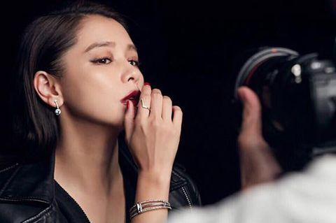 Beauty, Lip, Black hair, Mouth, Photography, Hand, Audio equipment, Singer, Model, Nail,