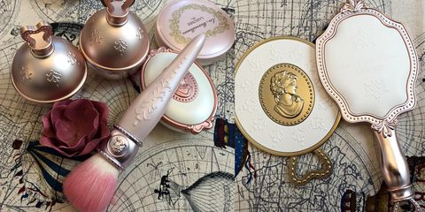 Dishware, Serveware, Metal, Circle, Souvenir, Ceramic, Kitchen utensil, Still life photography, Cutlery, Porcelain,