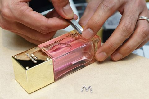 Finger, Hand, Nail, Thumb, Magenta, Wrist, Metal, Material property,