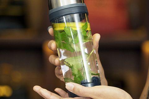 Finger, Liquid, Bottle, Drinkware, Nail, Thumb, Transparent material, Cylinder, Solution, Glass bottle,