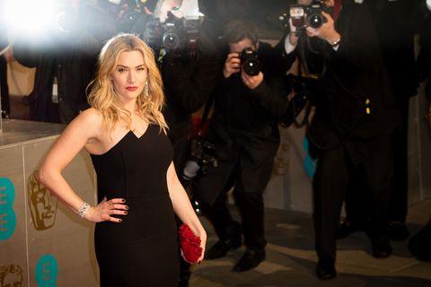 Camera, Dress, Photographer, Lens, Video camera, Film camera, Digital camera, Camera lens, Cocktail dress, One-piece garment,