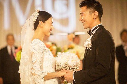 Smile, Bridal clothing, Event, Bridal veil, Veil, Photograph, Coat, Suit, Outerwear, Happy,