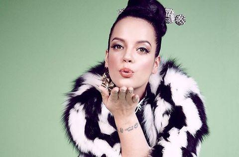 Lip, Textile, Eyelash, Fashion accessory, Fur clothing, Style, Black hair, Fashion model, Natural material, Costume accessory,