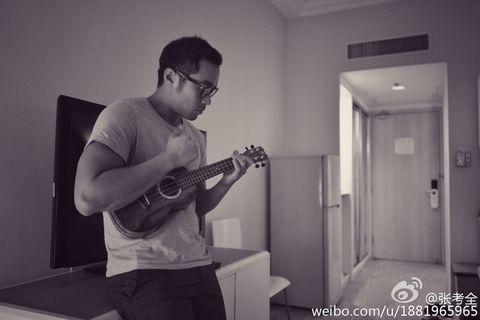 Guitar, Standing, Musician, String instrument, Musical instrument, Room, Arm, Plucked string instruments, Guitarist, Photography,