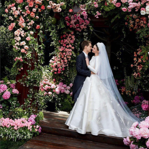 Petal, Dress, Flower, Photograph, Bridal clothing, Pink, Bride, Formal wear, Coat, Wedding dress,