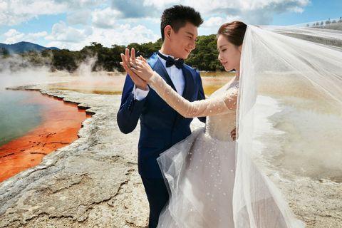 Trousers, Bridal clothing, Dress, Coat, Bride, Photograph, Bridal veil, Outerwear, Happy, Wedding dress,