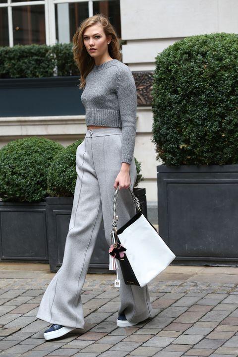 Shoulder, Joint, Outerwear, Style, Bag, Street fashion, Waist, Flowerpot, High heels, Shoulder bag,