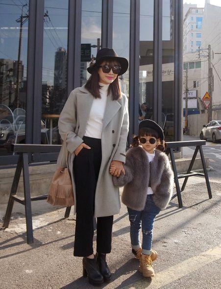 Clothing, Eyewear, Leg, Brown, Trousers, Coat, Hat, Textile, Outerwear, Standing,
