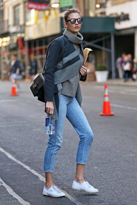 Eyewear, Road, Infrastructure, Street, Denim, Textile, Goggles, Standing, Outerwear, Human leg,