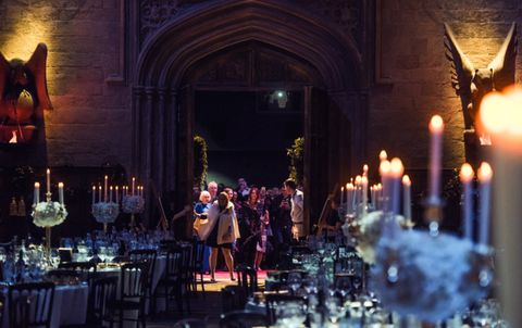 Lighting, Function hall, Candle, Hall, Chair, Tradition, Ceremony, Interior design, Arch, Candle holder,