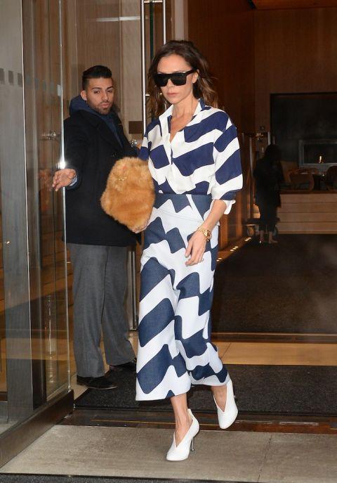 Eyewear, Shoulder, Textile, Standing, Outerwear, Sunglasses, Style, Coat, Dress, Street fashion,