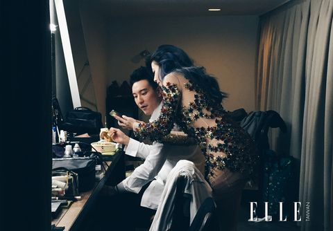 Sitting, Black hair, Curtain, Window treatment, Flash photography, Long hair, Window covering, Fashion model, Cosmetics, Boot,