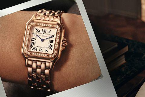 Watch, Analog watch, Watch accessory, Wrist, Fashion accessory, Brand, Jewellery, Material property, Font, Rectangle,