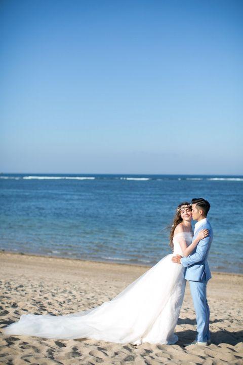 Clothing, Bridal clothing, Trousers, Dress, Coastal and oceanic landforms, Photograph, Coat, Happy, Bride, Wedding dress,