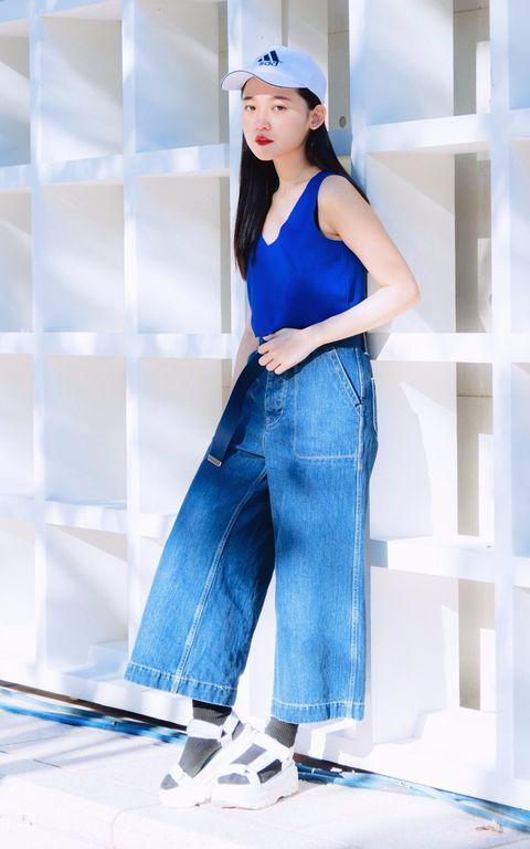 Blue, Cap, Sleeve, Denim, Shoulder, Textile, Standing, Style, Street fashion, Elbow,