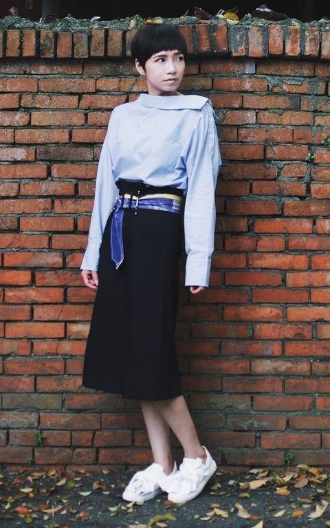 Clothing, Brick, Sleeve, Brickwork, Style, Street fashion, Waist, Belt, Costume, Building material,