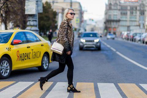 Road, Land vehicle, Vehicle, Street, Infrastructure, Car, Outerwear, Sunglasses, Urban area, Street fashion,