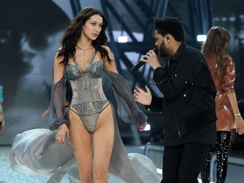 Arm, Leg, Human body, Microphone, Thigh, Leotard, Musical ensemble, Fashion model, Lingerie, Undergarment,
