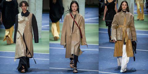 Footwear, Sleeve, Coat, Collar, Standing, Style, Costume design, Uniform, Overcoat, Costume,
