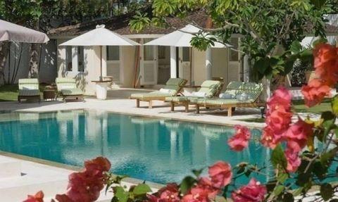 Swimming pool, Property, Petal, Flower, Real estate, Resort, Sunlounger, Outdoor furniture, Shade, Villa,