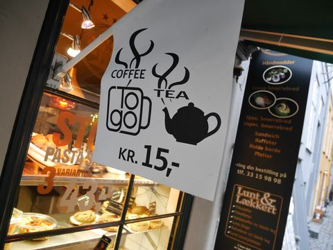 Signage, Advertising, Poster, Banner, Dessert, Comfort food, Delicacy, Display case, Sign, Graphic design,