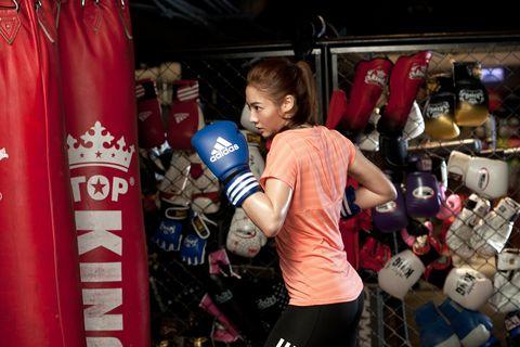 Sports uniform, Glove, Boxing glove, Boxing equipment, Sports gear, Contact sport, Boxing, Striking combat sports, Sports jersey, Combat sport,