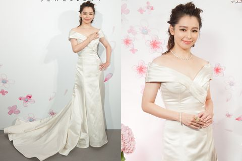 Clothing, Ear, Hairstyle, Skin, Sleeve, Dress, Shoulder, Textile, Joint, Gown,