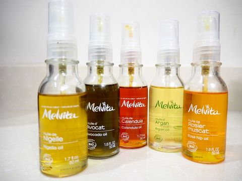 Liquid, Product, Bottle, Orange, Bottle cap, Fluid, Amber, Logo, Plastic bottle, Peach,