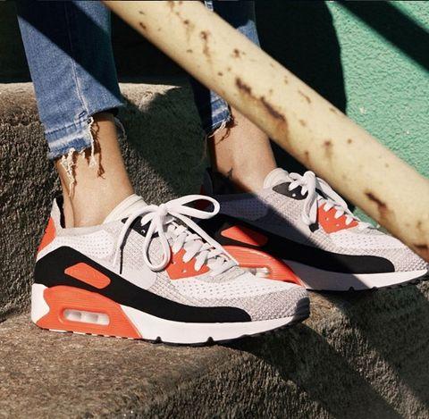 Human leg, Joint, Shoe, White, Athletic shoe, Orange, Carmine, Logo, Fashion, Sneakers,