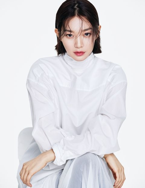 White, Clothing, Beauty, Hairstyle, Neck, Sitting, Shoulder, Lip, Arm, Blouse,