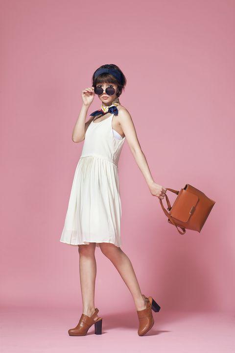 Shoulder, Human leg, Hand, Dress, Joint, Style, Drum, Waist, Fashion accessory, One-piece garment,