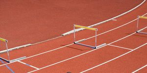 Track and field athletics, Shoe, Hurdle, Sport venue, Athletic shoe, Hurdling, Sports uniform, Recreation, Jumping, Human leg,