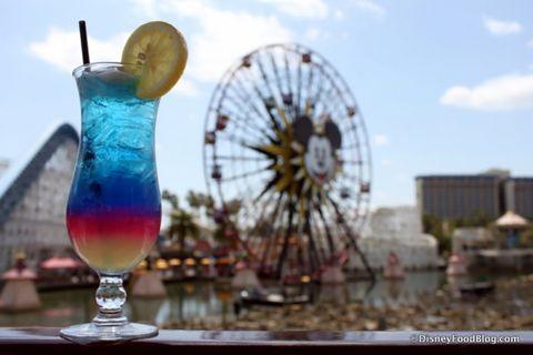 Nature, Ferris wheel, Daytime, Drinkware, Liquid, Glass, Fluid, Photograph, Drink, Tableware,