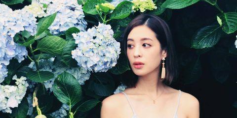 Petal, Shoulder, Flower, Jewellery, Flowering plant, Beauty, Shrub, Black hair, Chest, Spring,