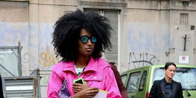 Footwear, Trousers, Land vehicle, Textile, Outerwear, Pink, Jacket, Coat, Style, Street fashion,