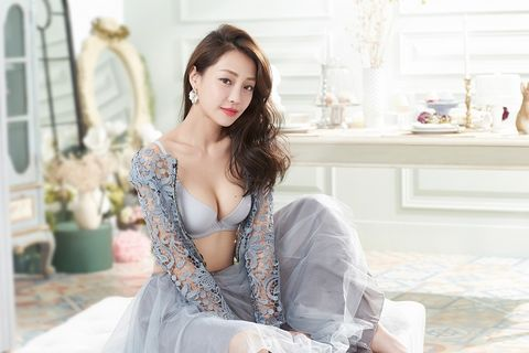 Flowerpot, Sitting, Fashion model, Beauty, Model, Photo shoot, Long hair, Street fashion, Embellishment, Day dress,