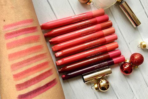 Pink, Red, Lip gloss, Cosmetics, Material property, Lipstick, Fashion accessory, Magenta, Peach, Metal,